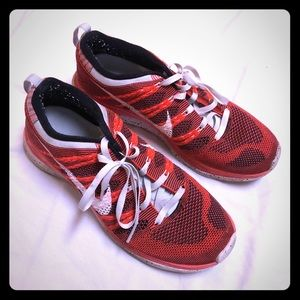 Nike flyknit one 9.5 orange & black running shoes